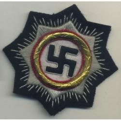 Croce tedesca in distintivo oro tessuto. Corona in metallo coperta 1941