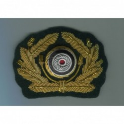 Bullion oakleaf wreath and cockade for visor caps. Made with gold bullion wire on a dark green backing